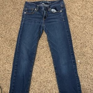 American Eagle low rise dark wash jeans.